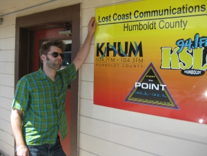 Ivan at KHUM sign